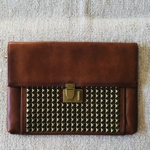 The Legacy Lock Clutch in Studded Leather